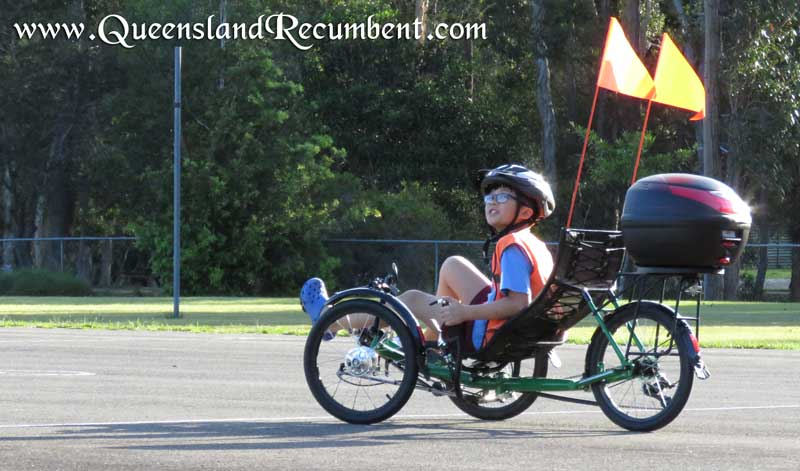 Recumbent trikes with high-visibility flags