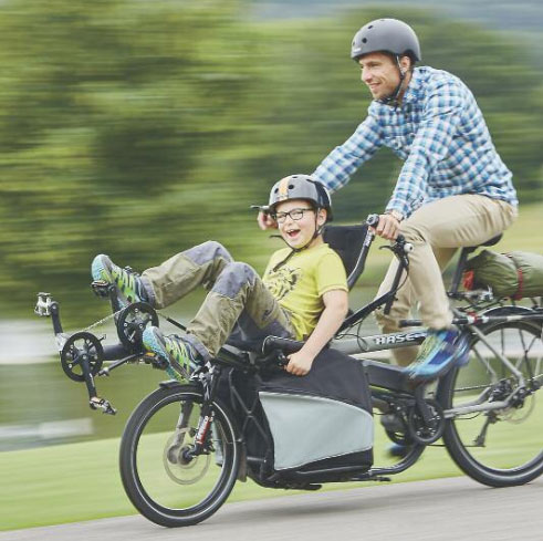Achieve greater inclusion in the community on a recumbent trike.